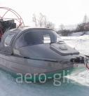 тентованный аэроглиссер на снегу